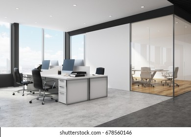 Corner of a white and black open space office interior with rows of computer tables with desktops standing on them. 3d rendering mock up