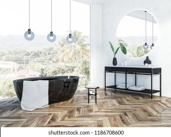 Corner of white brick bathroom with a black bathtub, a round mirror above a black vanity unit and panoramic window. 3d rendering