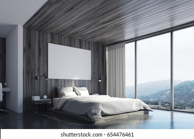 Corner of a wooden wall bedroom interior with a double bed, a bedside table, a horizontal poster and a large window with mountain view. 3d rendering, mock up