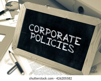 Corporate Policies Concept Hand Drawn on Chalkboard on Working Table Background. Blurred Background. Toned Image. 3D Render.