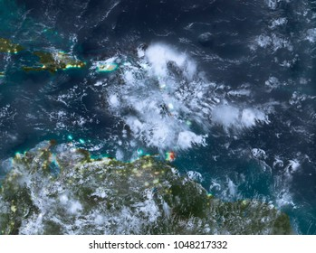 Country of Caribbean in red on planet Earth with clouds at night. 3D illustration. Elements of this image furnished by NASA.