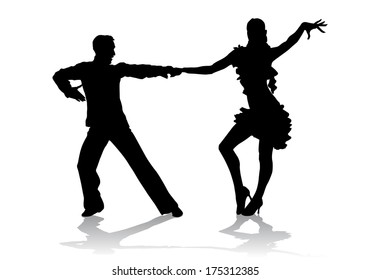 A couple in costumes dancing Latin dances