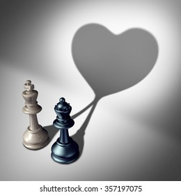 Couple in love as a valentine's day concept as a white king and black queen chess piece casting a united cast shadow coming together in a romantic relationship as an attraction symbol.