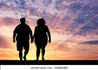 Couple with overweight on sunset background. Overweight concept