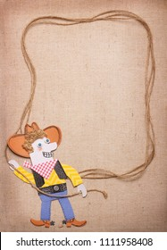 Cowboy in american wild west hat with lasso for design background