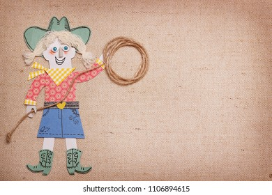 Cowgirl in western clothes with cowboy lasso in hands.Paper cut application for text