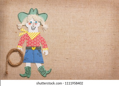 Cowgirl in western clothes with cowboy lasso in hand.Paper cut application background for text