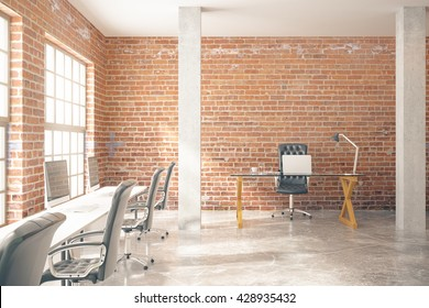 Coworking office interior with computers, concrete floor, red brick walls, columns and windows. 3D Rendering