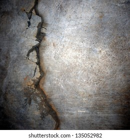 cracked  and scratched metal surface ; abstract grunge background