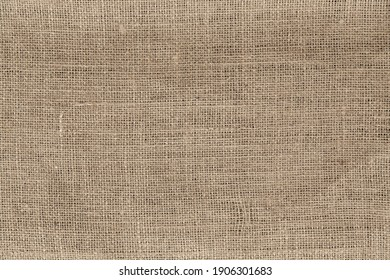Cream abstract Hessian or sackcloth fabric or hemp sack texture background. Wallpaper of artistic wale linen canvas. Blanket or Curtain of cotton pattern with space for text decoration. Light patterne