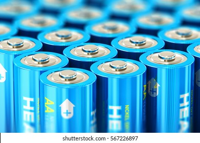Creative abstract 3D render illustration of the macro view of group of blue AA size 1.5 volts alkaline cell batteries or rechargeable accumulators with selective focus effect