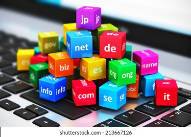 Creative abstract global internet communication PC technology and web telecommunication business computer concept: macro view of group of color cubes with domain names on laptop or notebook keyboard