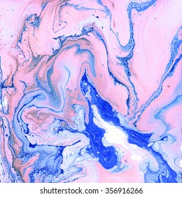 Creative background with abstract acrylic painted waves. Beautiful marble texture. Handmade surface. Blue and pink colors.