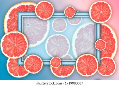 Creative background made of summer tropical fruit grapefruit. Frame with place for text.