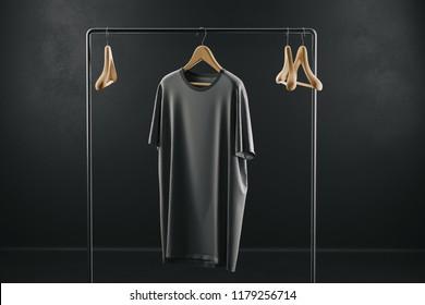 Creative black color t-shirt Mockup on a hanger on black background. 3D rendering