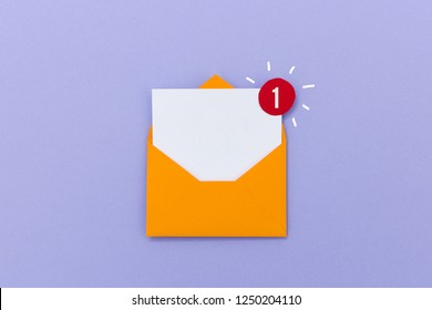 Creative colorful paper composition of envelope with empty letter and red notification icon showing one new message