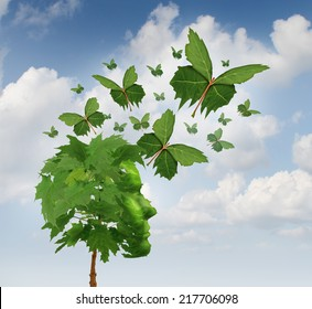 Creative communication and intelligent marketing concept as a tree shaped as a human head with flying leaves as leaf butterflies spreading the message and sharing innovative thoughts and imagination.