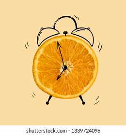 Creative idea layout fresh orange slice alarm clock on pastel orange background. minimal idea business creative concept.