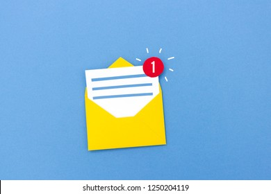 Creative paper composition of letter in envelope with counting icon showing one new message on blue background