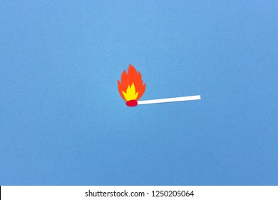 Creative simple paper match illustration lit and burning on blue background
