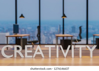 creativity logo on clean wooden desk in modern office with skyline view 3d rendering