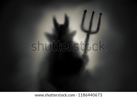 Creepy Devil silhouette behind