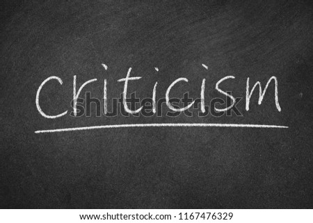 criticism concept word on a blackboard background