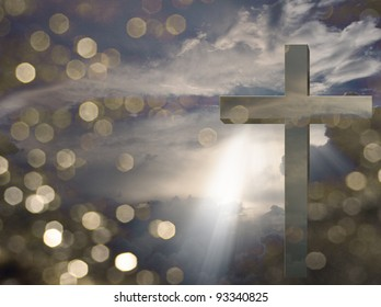 Cross and light beams down from sky