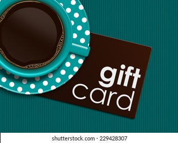 cup of coffee with gift card lying on tablecloth