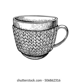 Cup in knitted cozy sweater. Hand drawn illustration. Warm coffee or tea drink in cold weather. Christmas sketch