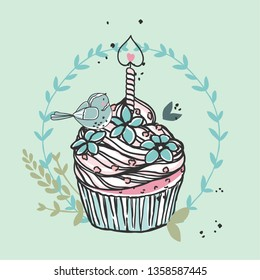 cupcake with candle and bird