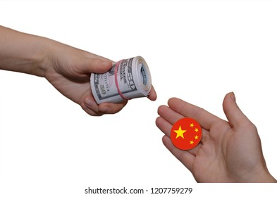 Currency exchange concept. Roll of Cash on hand and coin with Chinese flag on another hand.