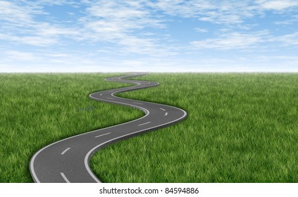 Curved winding asphalt road on a green grass horizon with a blue sky represented by a single highway representing a clear focused strategic trip to a planned destination and journey.