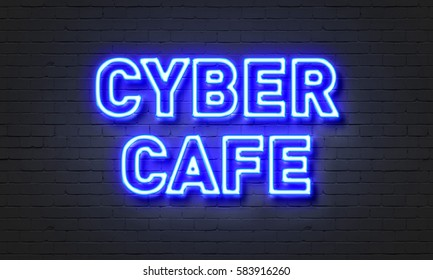Cyber cafe neon sign on brick wall background