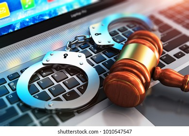 Cyber crime, online piracy and internet web hacking concept: 3D render illustration of the macro view of metal handcuffs and wooden judge mallet, gavel or hammer on laptop notebook computer keyboard
