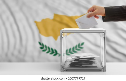 Cyprus elections concept. Voter's hand on Cyprus waving flag background. 3d illustration