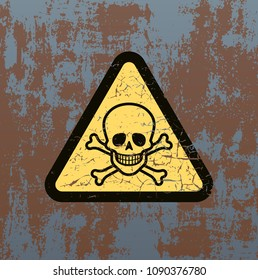 Danger sign with skull on old rusty metal background