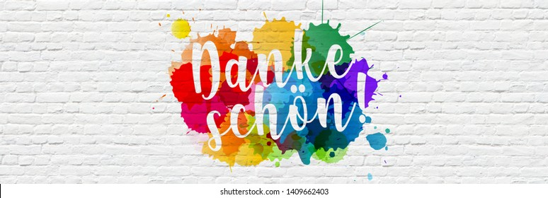 """"""" Danke schön """" : Thank you in german, with colored splashes on a brick wall"""