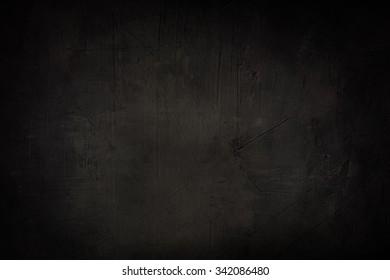 dark grey grunge background or texture with black vignette borde