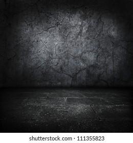 Dark grungy stone room or chamber.