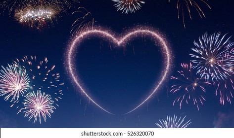 A dark night sky with a sparkling red firecracker in the shape of a heart composed into.(series)