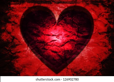 Dark passion: glowing red heart black. Rough vibrant red texture with burnt edges.