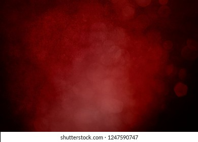Dark red grungy christmas background with glitter bokeh lights