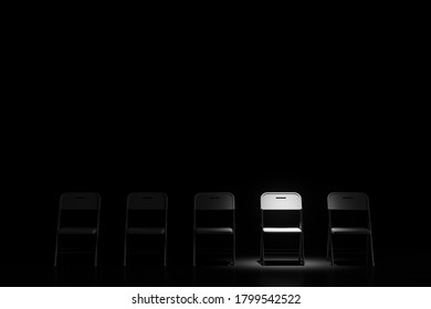 Dark room with chairs with a single isolated chair illuminated by a spotlight. Concept of choice and uniqueness. 3d rendering