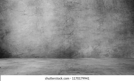Dark room with light background.