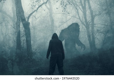 A dark scary concept. Of a man watching a mysterious bigfoot figure, walking through a forest. Silhouetted against trees. On a foggy winters day. With a grunge, textured edit.