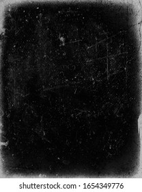Dark scratched grunge background, old film effect, distressed scary texture