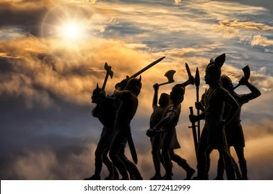 Dark silhouettes of well armed attacking Vikings (vintage toy plastic soldiers) against the sky with thunder clouds and sun, Old Norse mythology, Odin, Valhalla and Asgard themes