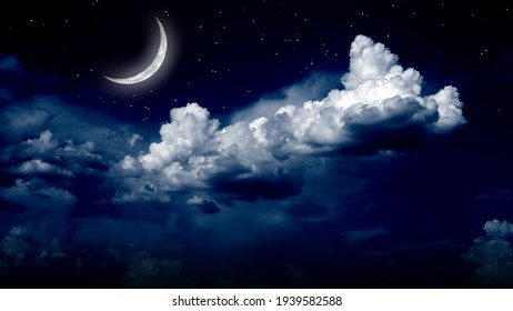 dark sky with white clouds and shiny moon