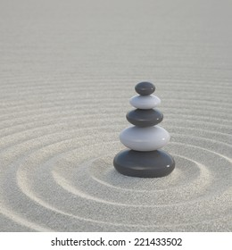 Dark and white zen stones stacked on a wide sands symbol for calmness and relaxation